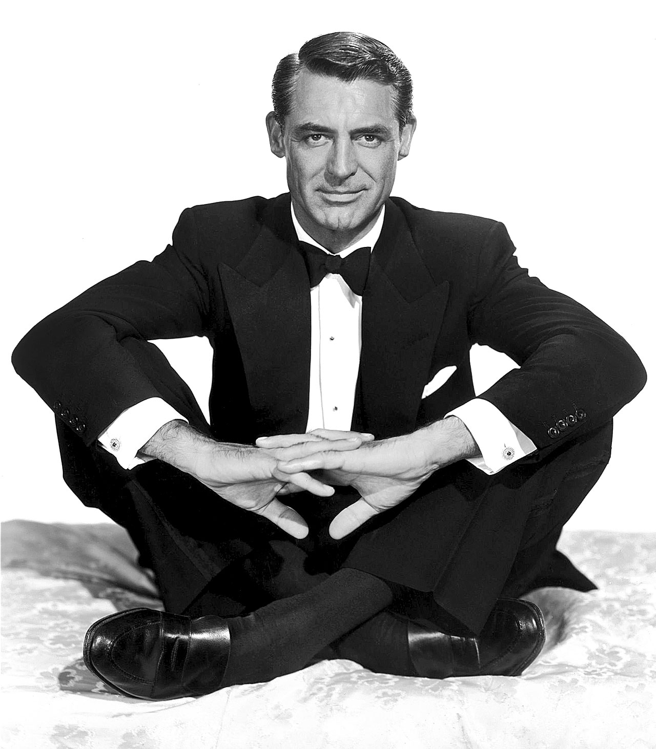 Cary-Grant-Sitting-Indian-Style-wearing-a-tuxedo